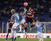 Calcio, Serie A: Lazio vs Bologna. Roma, stadio Olimpico, 22 agosto 2015.<br /> From left, Lazio&rsquo;s Dusan Basta and Marco Parolo and Bologna&rsquo;s Matteo Brighi jump for the ballduring the Italian Serie A football match between Lazio and Bologna at Rome's Olympic stadium, 22 August 2015.<br /> UPDATE IMAGES PRESS/Isabella Bonotto