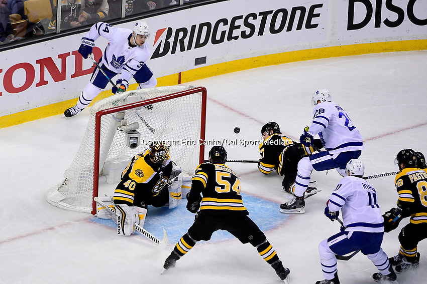 April 21, 2018: Toronto Maple Leafs center Auston Matthews (34) feeds the puck to right wing Connor Brown (28) for a score against Boston Bruins goaltender Tuukka Rask (40) during game five of the first round of the National Hockey League's Eastern Conference Stanley Cup playoffs between the Toronto Maple Leafs and the Boston Bruins held at TD Garden, in Boston, Mass. Toronto defeats Boston 4-3, Boston leads Toronto 3 games to 2 in the best of 7 series.