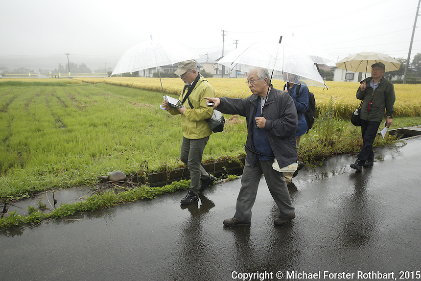 Nuclear scientist Ikuro Anzai and his dosimetry team measure radiation levels near Torikawa Nursery School in Fukushima City, and then report their findings to school director Miyoko Sato. Full caption to come.<br /> <br /> &copy; Michael Forster Rothbart Photography<br /> www.mfrphoto.com &bull; 607-267-4893<br /> 34 Spruce St, Oneonta, NY 13820<br /> 86 Three Mile Pond Rd, Vassalboro, ME 04989<br /> info@mfrphoto.com<br /> Photo by: Michael Forster Rothbart<br /> Date:  9/25/2015<br /> File#:  Canon &mdash; Canon EOS 5D Mark III digital camera frame A15852