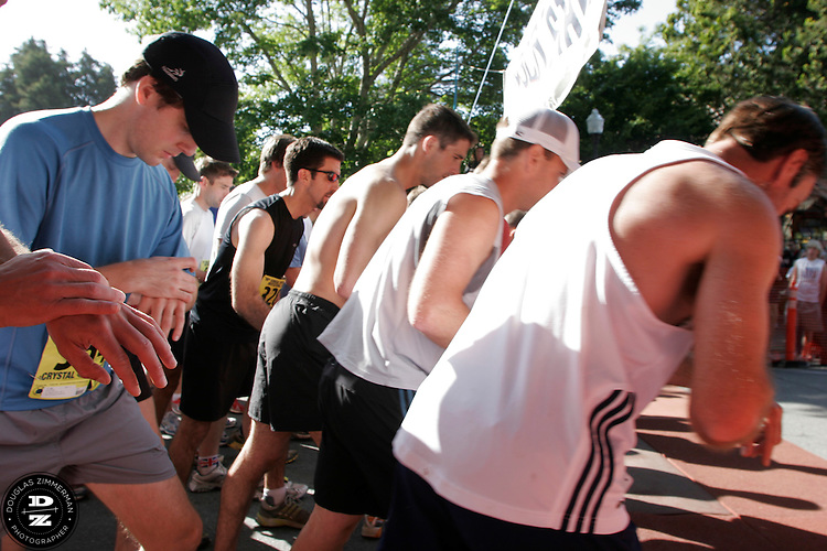 A group of runners set their time watches before beginning the 98th Dipsea Race from the starting line in downtown Mill Valley, Calif. enroute to Stinson Beach over Mt. Tamalapais  on Sunday, June 8, 2008.