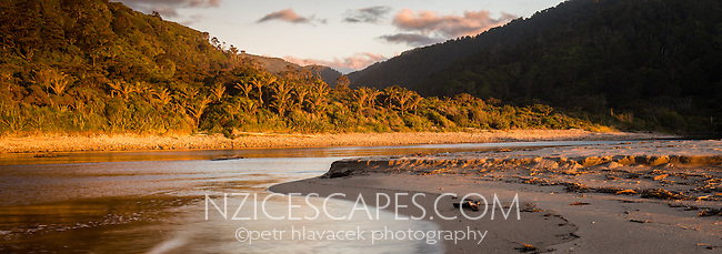 Sunset on beach with Kohaihai River near Karamea, Kahurangi National Park, Buller Region, West Coast, New Zealand, NZ
