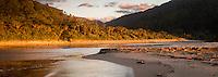 Sunset on beach with Kohaihai River near Karamea, Kahurangi National Park, Buller Region, West Coast, New Zealand, NZ