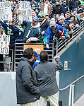 Seattle Seahawks super fan Rob Larsen heckles St. Louis Rams  Head Coach Jeff Fisher as he heads into the locker room during halftime at CenturyLink Field in Seattle, Washington on December 28, 2014.   The Seahawks officially wrapped up the No. 1 seed in the NFC playoffs shortly after beating the Rams, 20-6. Despite the Cowboys and Packers also winning to finish 12-4, the Seahawks (12-4) won the multi-team tiebreaker and earned home-field advantage throughout the playoffs for the second consecutive season.  ©2014. Jim Bryant Photo. All Rights Reserved.