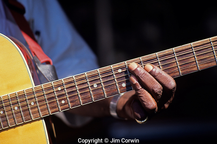 Black musician playing guitar on the street along the AVE Univeristy Distrcict Seattle Washington State USA