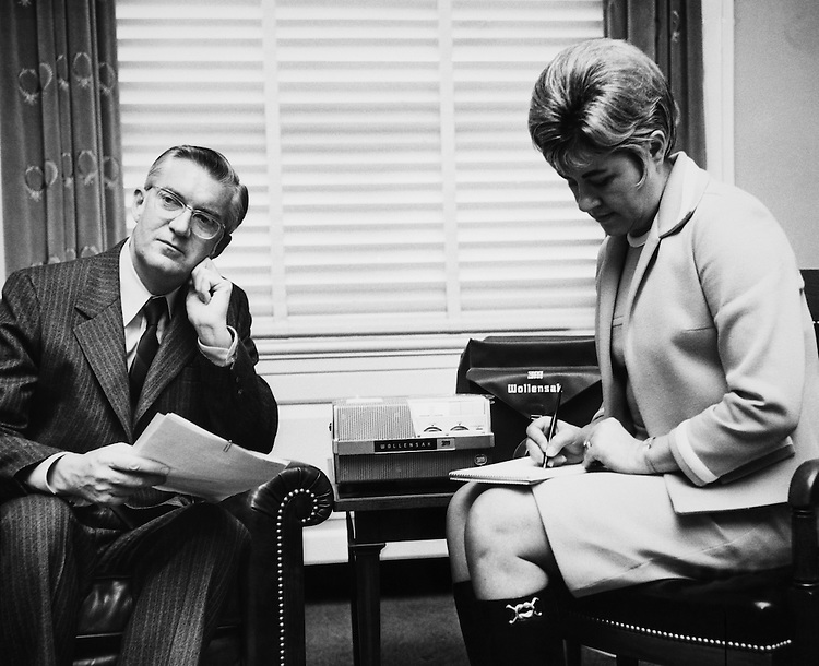 Rep. R. James Harvey, R-Mich. listens to a tape sent in by a kid from his district on ecology. Secretary takes it down in short hand. 1966 (Photo by Mickey Senko/CQ Roll Call)