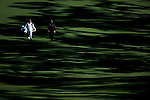 AUGUSTA, GA: APRIL 10 - Angel Cabrera walks down the second fairway with his caddie during the first round of the 2014 Masters held in Augusta, GA at Augusta National Golf Club on Thursday, April 10, 2014. (Photo by Donald Miralle)