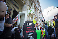 Hundreds of workers and supporters march through the streets of Soho on Saturday, June 29, 2013 stopping off at various clothing retailers including Gap's Piperlime protesting the companies' refusal to the Bangladesh Safety Accord guaranteeing better safety conditions in Bangladeshi factories. In April a collapse of an enormous garment factory killed over 1000 workers. (© Richard B. Levine)