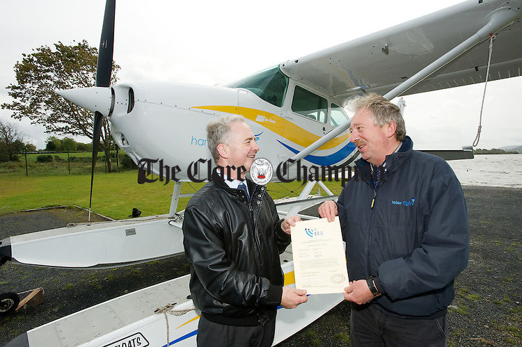 Pieter Van Velzen of the Irish Aviation Authority presents a licence to Emelyn Heaps of Harbour Flights at a ceremony to mark the official granting of the first ever Commercial Seaplane Base license to Harbour Flights Ireland Ltd, by the Irish Aviation Authority. Photograph by John  Kelly..
