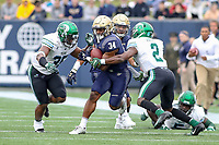 Annapolis, MD - October 26, 2019: Navy Midshipmen fullback Jamale Carothers (34) gets tackled by several Tulane Green Wave defenders during the game between Tulane and Navy at  Navy-Marine Corps Memorial Stadium in Annapolis, MD.   (Photo by Elliott Brown/Media Images International)