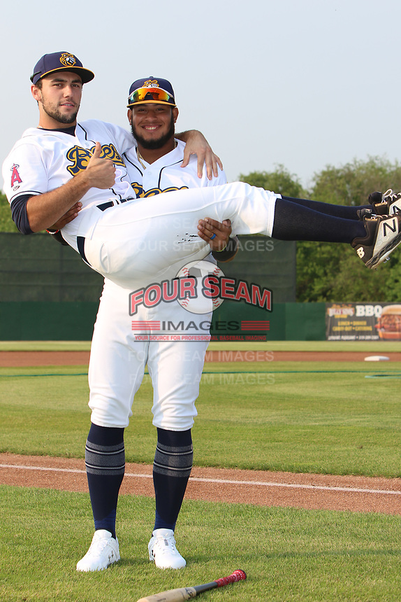 Burlington Bees Kevin Maitan holds teammates Nonie Williams for a photo before a Midwest League game against the Quad Cities River Bandits on May 31, 2019 at Community Field in Burlington, Iowa.  Quad Cities defeated Burlington 13-10.  (Travis Berg/Four Seam Images)