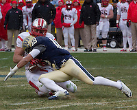 Pitt defensive back Jarred Holley (18) makes a tackle on Rutgers tight end Paul Carrezola. The Pitt Panthers defeat the Rutgers Scarlet Knights 27-6 on Saturday, November 24, 2012 at Heinz Field , Pittsburgh, PA.