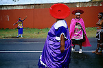 SOWETO, SOUTH AFRICA MARCH 8: Unidentified Zulu women dressed in traditional clothing stop the traffic as they are marching with about fifty virgins on a road on March 8, 2005 in Soweto, Johannesburg, South Africa. This to celebrate their virginity. The girls were earlier in the day checked if they were virgins or not. Soweto is South Africa?s largest township and it was founded about one hundred years to make housing available for black people south west of downtown Johannesburg. The estimated population is between 2-3 million. Many key events during the Apartheid struggle unfolded here, and the most known is the student uprisings in June 1976, where thousands of students took to the streets to protest after being forced to study the Afrikaans language at school. Soweto today is a mix of old housing and newly constructed townhouses. A new hungry black middle-class is growing steadily. Most residents work in Johannesburg but the last years many shopping malls has been built, and people are starting to spend their money in Soweto.  (Photo by Per-Anders Pettersson).