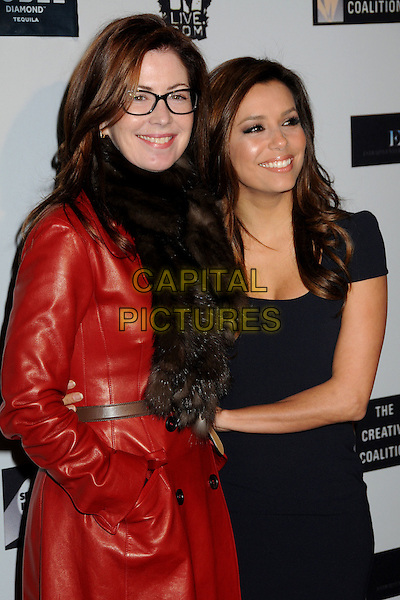 DANA DELANY & EVA LONGORIA PARKER .The Creative Coalition's Spotlight Initiative Dinner held at the Luxe Hotel, Westwood, California, USA..December 8th, 2009.half length jacket dress hand in pocket delaney red leather black fur scarf glasses .CAP/ADM/BP.©Byron Purvis/AdMedia/Capital Pictures.