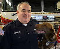 UPPER SOUTHAMPTON, PA - APRIL 30: Southampton Fire Chief Tom Brown poses with his rescue dog Phoenix in the fire house April 30, 2014 in Upper Southampton, Pennsylvania. Brown and his dog were called to the building collapse last year at the Salvation Army Thrift store in center city Philadelphia on June 5. Brown and Phoenix were able to find a trapped 61-year-old woman alive. (Photo by William Thomas Cain/Cain Images)