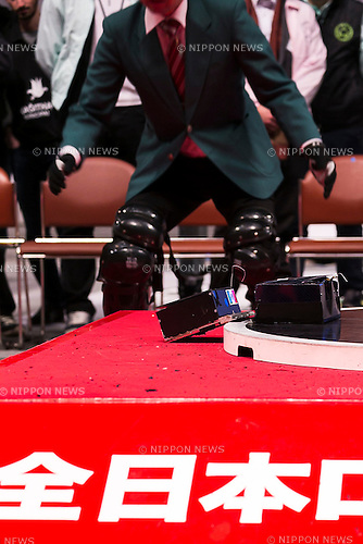 Sumo robots fight at  the International Robot Sumo Tournament 2015, in the Ryogoku Sumo Hall (Ryogoku Kokugikan) on December 13, 2015. The annual competition brings the winners from 14 robot sumo tournaments held globally, plus the Japanese winners of the All Japan Robot-Sumo National Tournament and All Japan Robot-Sumo Tournament (High-School class) to fight for the world's first place in two divisions: autonomous and radio controlled. The international tournament is part of the All Japan Robot-Sumo Tournament which has been held in various countries since 1989. According to the rules the robot wrestler loses when the robot is forced outside the sumo ring, simulating a traditional sumo fight. (Photo by Rodrigo Reyes Marin/AFLO)