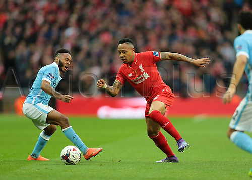 28.02.2016. Wembley Stadium, London, England. Capital One Cup Final. Manchester City versus Liverpool. Liverpool Defender Nathaniel Clyne wins the ball off Manchester City Midfielder Raheem Sterling