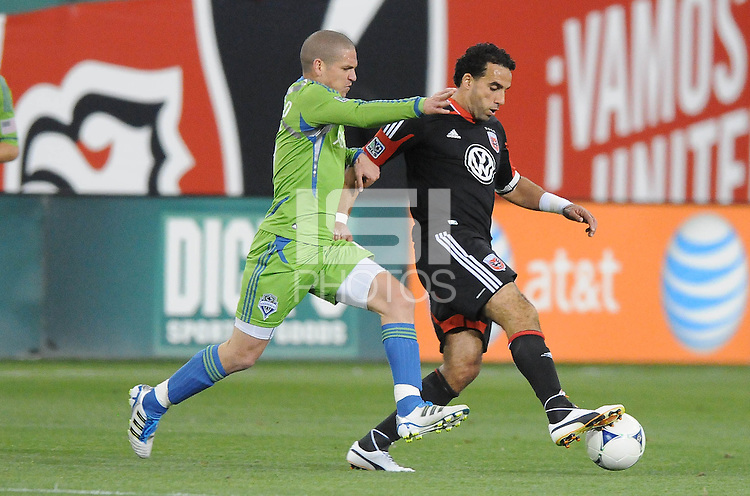 D.C. United forward Dwayne De Rosario (7) shields the ball against Seattle Sounders midfieler Osvaldo Alonso (6)  D.C. United tied the Seattle Sounders, 0-0 at RFK Stadium, Saturday April 7, 2012.