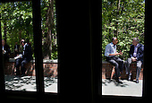 United States President Barack Obama talks with Prime Minister Stephen Harper of Canada on the Laurel Cabin patio during the G8 Summit at Camp David, Md., May 19, 2012. .Mandatory Credit: Pete Souza - White House via CNP