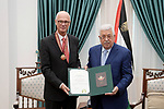 Palestinian President Mahmoud Abbas gives the Chilean ambassador the Medal of the Star of Jerusalem, in the West Bank city of Ramallah on Aug. 05, 2018. Photo by Thaer Ganaim