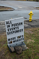 """A sign reads """"All in person events suspended / More Info on Website"""" outside All Saints Church during the widespread public gathering space shutdown in response to the coronavirus COVID-19 global pandemic in Belmont, Massachusetts, on Fri., March 20, 2020."""