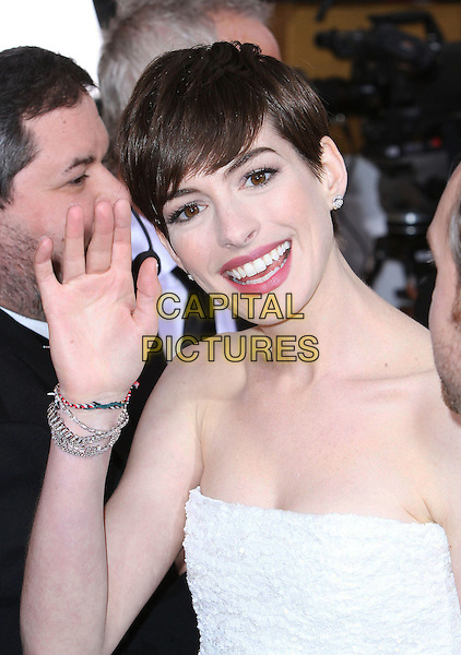 Anne Hathaway.70th Annual Golden Globe Awards held at the Beverly Hilton Hotel, Hollywood, California, USA..January 13th, 2013.globes headshot portrait white strapless smiling silver bracelets hand arm palm waving .CAP/ADM/SLP/COL.©Collin/Starlitepics/AdMedia/Capital Pictures.