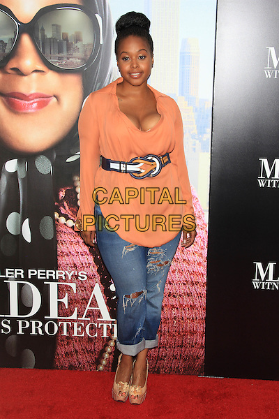 "Chrisette Michele (R&B singer).The Premiere of ""Madea's Witness Protection"" held at AMC Loews Lincoln Square Cinemas, New York, NY., USA..June 25th, 2012.full length orange top jeans denim belt ripped torn cleavage .CAP/LNC/TOM.©LNC/Capital Pictures."