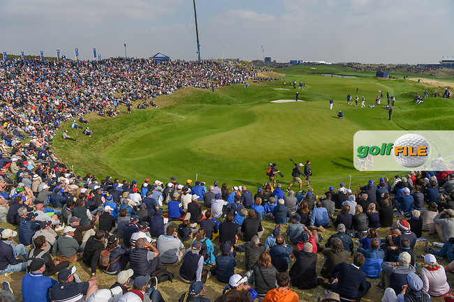 A wide view of the massive crowd around the green on 9 during Friday's foursomes of the 2018 Ryder Cup, Le Golf National, Guyancourt, France. 9/28/2018.<br /> Picture: Golffile | Ken Murray<br /> <br /> <br /> All photo usage must carry mandatory copyright credit (© Golffile | Ken Murray)