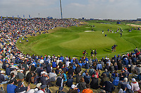 A wide view of the massive crowd around the green on 9 during Friday's foursomes of the 2018 Ryder Cup, Le Golf National, Guyancourt, France. 9/28/2018.<br /> Picture: Golffile | Ken Murray<br /> <br /> <br /> All photo usage must carry mandatory copyright credit (&copy; Golffile | Ken Murray)