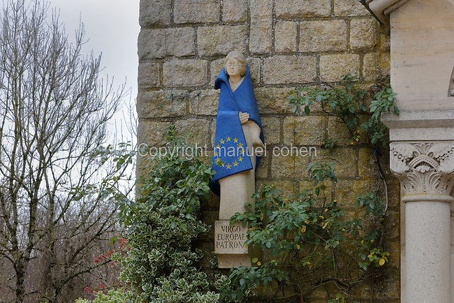 Statue of the Virgin, 1979, by Andre Messin Forfert, draped in a European flag as a symbol of peace and reconciliation, at the Chapelle Notre-Dame-de-l'Europe, or Chapel of Our Lady of Europe, a memorial chapel built 1934 by Louis-Alfred Berthemy, on the site of a church in the village of Fleury-devant-Douaumont, Verdun, Meuse, Lorraine, France, which was completely destroyed in the Battle of Verdun in World War One. Prior to the war the village had 400 inhabitants but found itself on the front line, was destroyed and never rebuilt. The chapel is a site of remembrance. Picture by Manuel Cohen