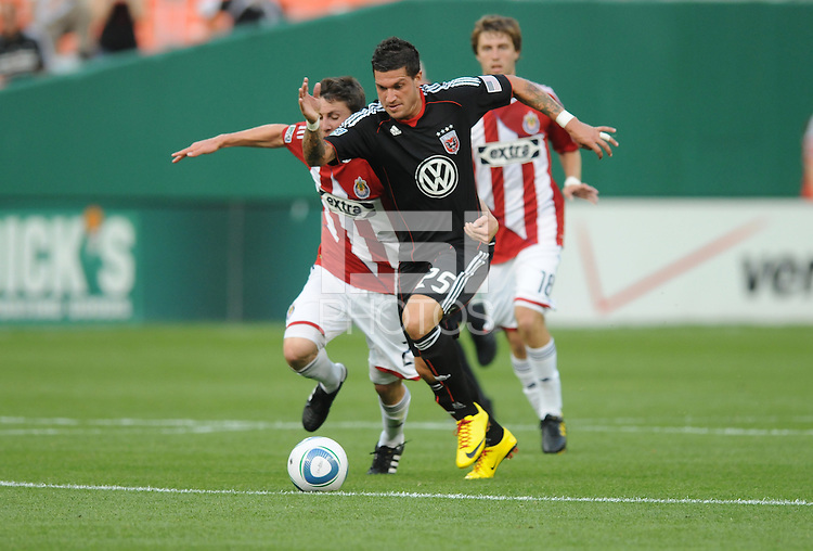 DC United forward Santino Quaranta (25) runs with the ball follow by Chivas USA midfielder Ben Zemanski (21).  DC United defeated Chivas USA 3-2 at RFK Stadium, Saturday May 29, 2010.