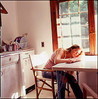 Woman sitting at kitchen table