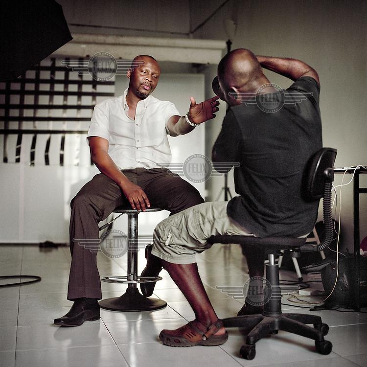 Photographer Nana Acquach shoots the artist and cameraman Nawuli Aftasiano.
