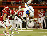 VERMILLION, SD - NOVEMBER 18: Dallas Goedert #86 from South Dakota State University is upended by Phillip Powell #21 from the University of South Dakota during their game Saturday afternoon at the DakotaDome in Vermillion. (Photo by Dave Eggen/Inertia)