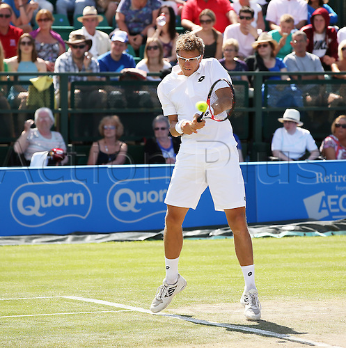 27.06.2015.  Nottingham, England. Aegon Nottingham Open Tennis Tournament. Backhand from finals winner Denis Istomin (UZB) who defeated Sam Querrey (USA) in straight sets