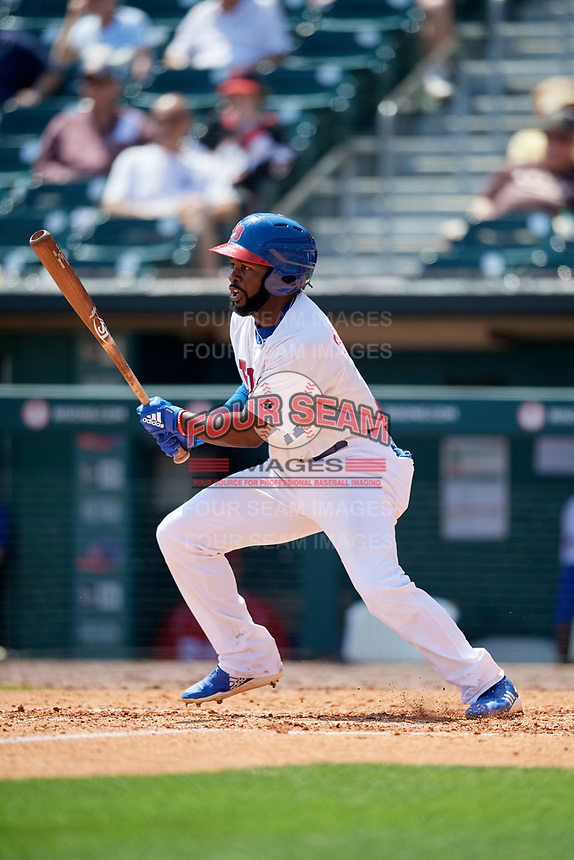 Buffalo Bisons left fielder Dwight Smith Jr. (21) follows through on a swing during a game against the Pawtucket Red Sox on June 28, 2018 at Coca-Cola Field in Buffalo, New York.  Buffalo defeated Pawtucket 8-1.  (Mike Janes/Four Seam Images)