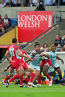 Manusamoa Tuilagi of Leicester Tigers is tackled by Joe Ajuwa of London Welsh during the Aviva Premiership match between London Welsh and Leicester Tigers at the Kassam Stadium on Sunday 2nd September 2012 (Photo by Rob Munro)