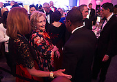 Former Secretary of State Hillary Rodham Clinton talks to a guest during a dinner for Medal of Freedom awardees at the Smithsonian National Museum of American History on November 20, 2013 in Washington, D.C.<br /> Credit: Kevin Dietsch / Pool via CNP