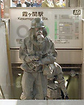 Japanese Self-Defense Force personnel wearing gas masks and protective clothing leave the Kasumigaseki Subway Station in Chiyoda-ku, Tokyo on March 20th, 1995. At around 8.00am in the morning members of the Aum Shirikyo Doomsday Cult released poisonous Sarin Gas in five coordinated attacks on trains travelling through Kasumigaseki and Nagatacho stations. This resulted in the death of 13 passengers and staff and over 6,000 injuries and was Japan's deadliest act of domestic terrorism.  (Photo by Mainichi Newspapers/AFLO)