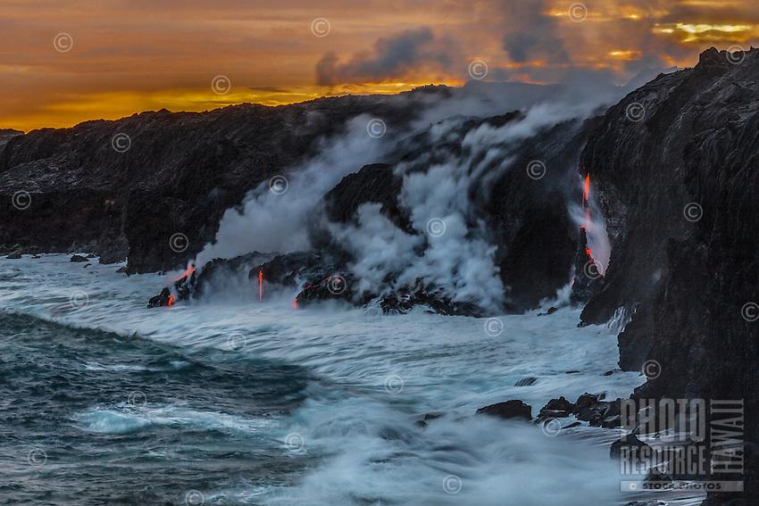 Steam rises when lava streams meet the ocean near Kalapana on the Big Island of Hawai'i.