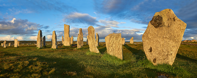 Panorama of the outer row of stones, 27 metres long,  leading to the central stone circle overlooking Loch Roag, circa 2900BC. Calanais Neolithic Standing Stone (Tursachan Chalanais) , Isle of Lewis, Outer Hebrides, Scotland.
