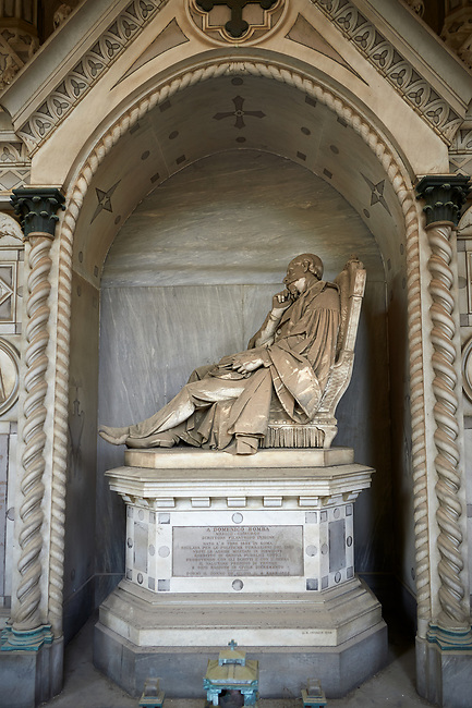 Picture and image of the stone sculpture of a man sitting in a chair on a plinth in Borgeois Realistic style. The Bomba family Tomb sculpted by G B Cevasco. Section D no 33, the monumental tombs of the Staglieno Monumental Cemetery, Genoa, Italy