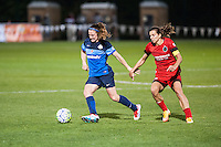 Kansas City, Mo. - Saturday April 23, 2016: FC Kansas City midfielder Heather O'Reilly (9) dribbles past Portland Thorns FC midfielder Tobin Heath (17) during a match at Swope Soccer Village. The match ended in a 1-1 draw.