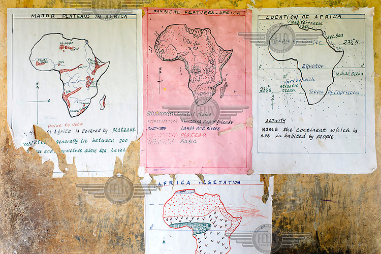 Geographical maps of Africa on the wall of a classroom at Aputiri Primary School.