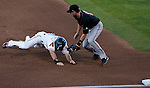 Reno Aces Adam Eaton is taged out by Fresno Grizzlies shortstop Nick Noonan at third during their game on Friday night August 10, 2012 at Aces Ballpark in Reno NV.