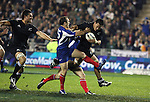 All Blacks loose forward Chris Masoe tries to burst through the French defence. Troy Flavell supports in the first international rugby test at Eden Park, Auckland, New Zealand, Saturday, June 02, 2007. The All Blacks beat France 42-11.