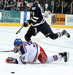SIOUX FALLS, SD - APRIL 12:  Kyle Schempp #6 from the Sioux Falls Stampede tries to leap over David Drake #3 from the Des Moines Buccaneers in the first period of their game Friday night at the Sioux Falls Arena. (Photo by Dave Eggen/Inertia)