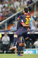 MADRID, ESPANHA, 29 AGOSTO 2012 - SUPERCUP DA ESPANHA -  REAL MADRID X BARCELONA - Lionel Messi (D) jogador do Barcelona  comemora gol durante partida contra o Real Madrid na final da da Supercup da Espanha contra o Barcelona em , no estadio Santiago Bernabeu, em Madri na Espanha, nesta quarta-fera, 29. (FOTO: ALFAQUI / BRAZIL PHOTO PRESS).