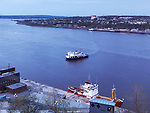 Ferry over St. Lawrence river at dusk, aerial view. Quebec City, Quebec, Canada. Traverse Québec-Lévis, Ville de Québec. Spring 2017.