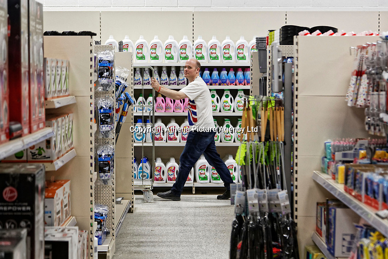 COPY BY TOM BEDFORD<br /> Pictured: Workers prepare the store before opening.<br /> Re: Trago Mills Mega Store, which opened its doors in Merthyr Tydfil, and is the largest store in Wales, UK. It is a £65m investment creating 350 jobs in one of Britain's biggest unemployment blackspots