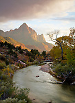 Utah, Southern, Zion National Park. Evenin glight touches the cliffs above the Virgin River in Zion National Park.